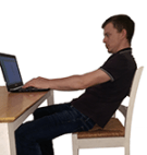 Sitting slouched at computer
