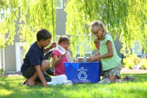 Children recycling in an effort to go green at school