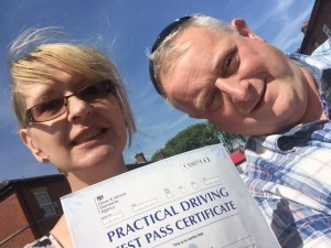 Helen Dunbar and Graham after passing her driving test in Bury