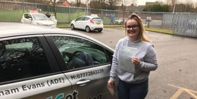 Niamh proudly shows off her driving test pass certificate