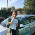 Elisha celebrating her driving test pass