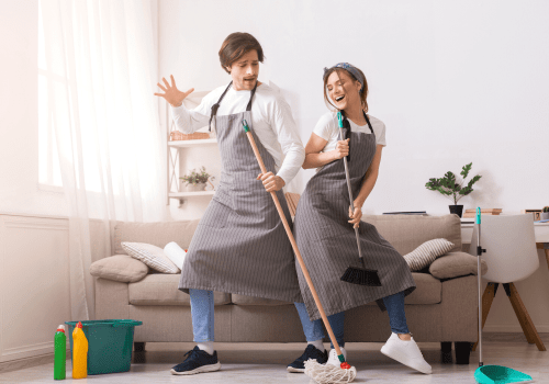 couple dancing and cleaning