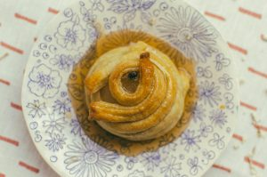 top down view of honey poached pear wrapped in puff pastry - The Mummy