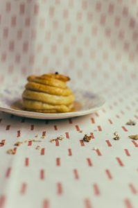 Photo of scattered bones with honey poached pear out of focus in the background - The Mummy