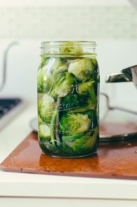 Brussels sprouts sitting in a jar with dill and pickling juices - The Mummy