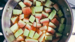 Watermelon rind simmering in pickling juices and spices - The Mummy