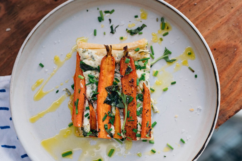 Top view of the Carrot and Ricotta Tart that we made for our Rear Window post. The tart is drizzled with olive oil and herbs