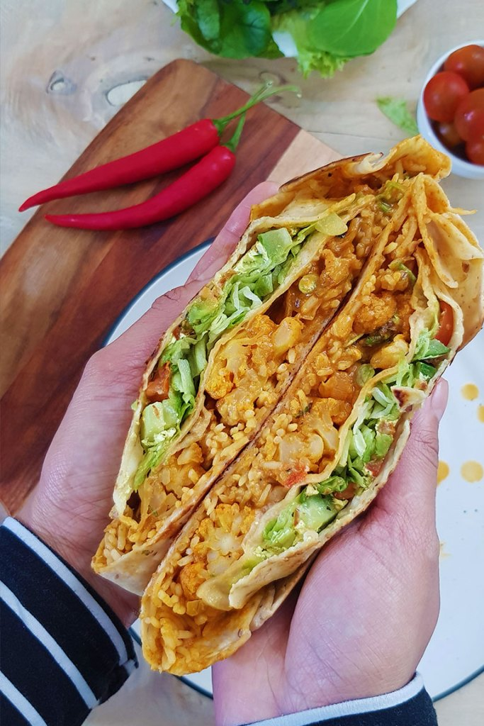 Holding crunchwrap in hands