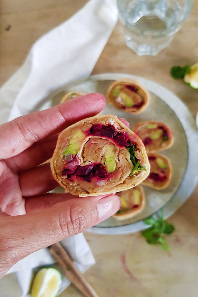 veggie tortilla roll ups in hand