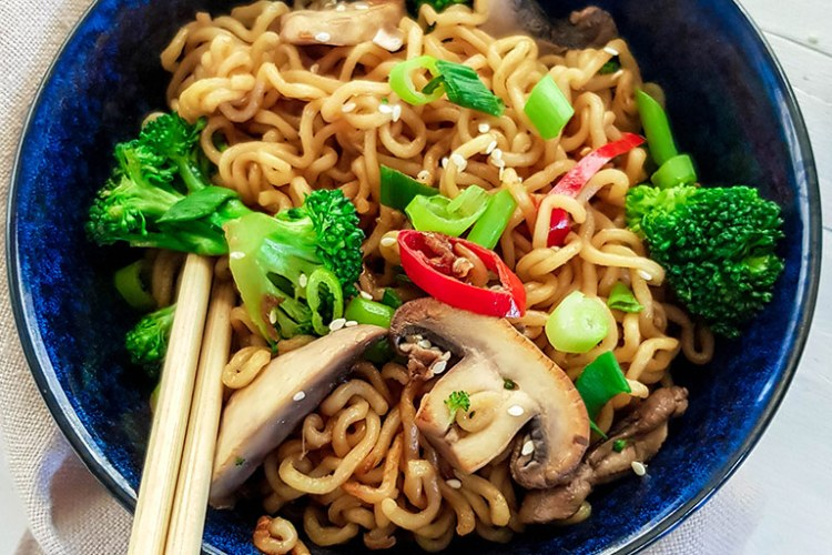 Ramen stir fry in a bowl with chopsticks