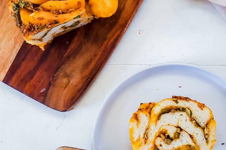 vegan babka slice on a plate with fork
