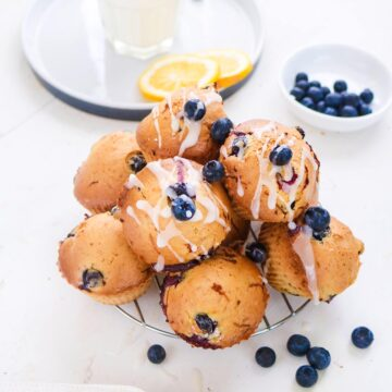 Vegan blueberry lemon muffins on a steel rack
