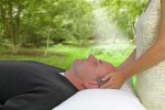 Reiki hands with white light healing energy on man outdoors