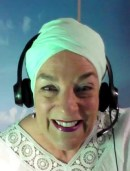 Nancy in headphones recording a meditation after a Zoom session