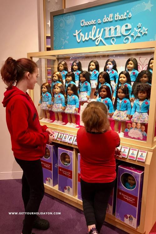 There are so many fun places to take pictures of your little girl and her doll. With every turn and approaching a new display, my girls were just in awe at all the detail in each case. That's why we've brought you 7 Tips For A Magical Experience To An American Girl Store. #americangirl #shopping #parenting #trulyme