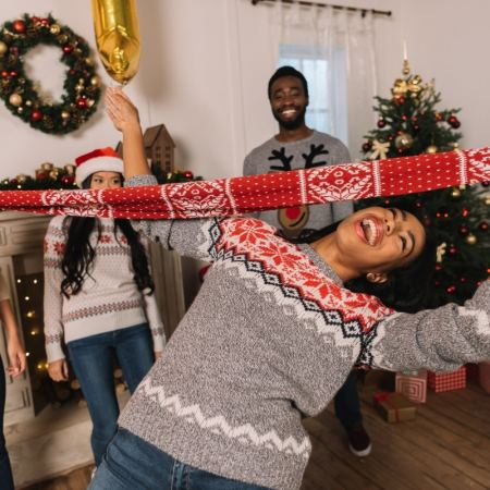 Adult Holiday Party Games including favorites like this Holiday Limbo Game! #play #party #minutetowinit #diyholiday