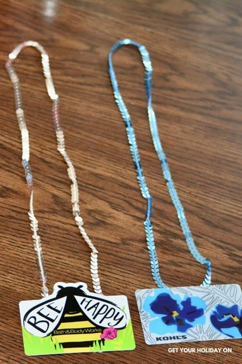 gift cards made into necklaces.