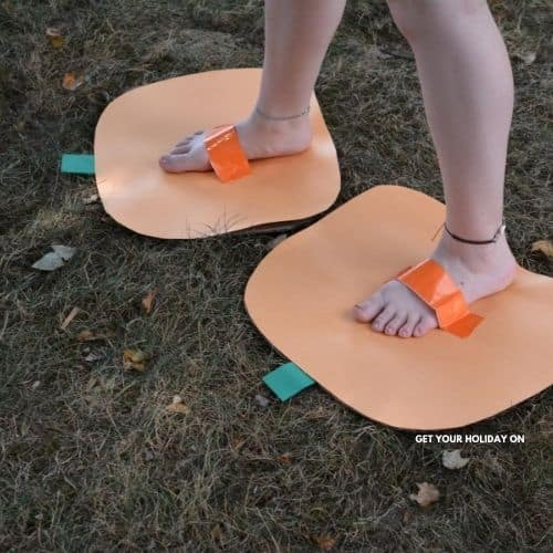 showing people how to make a pumpkin craft that they could put on their feet and wear.
