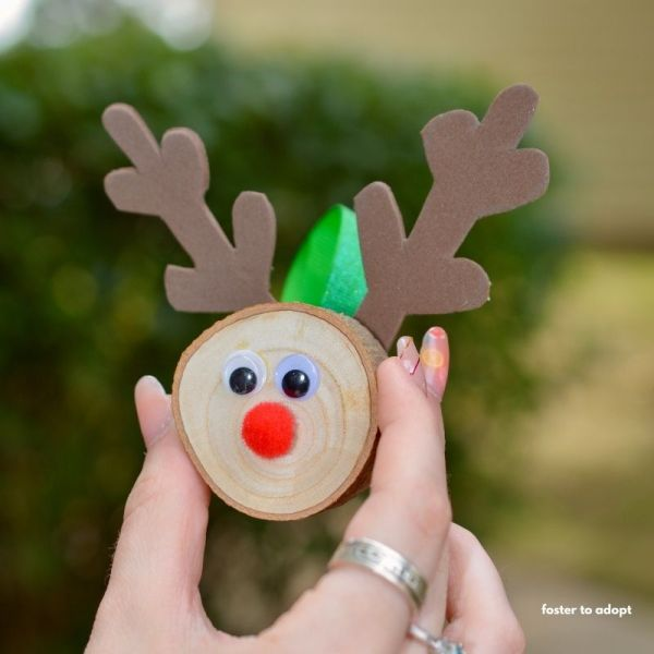 wood slice ornament decorated like a reindeer for the holidays.