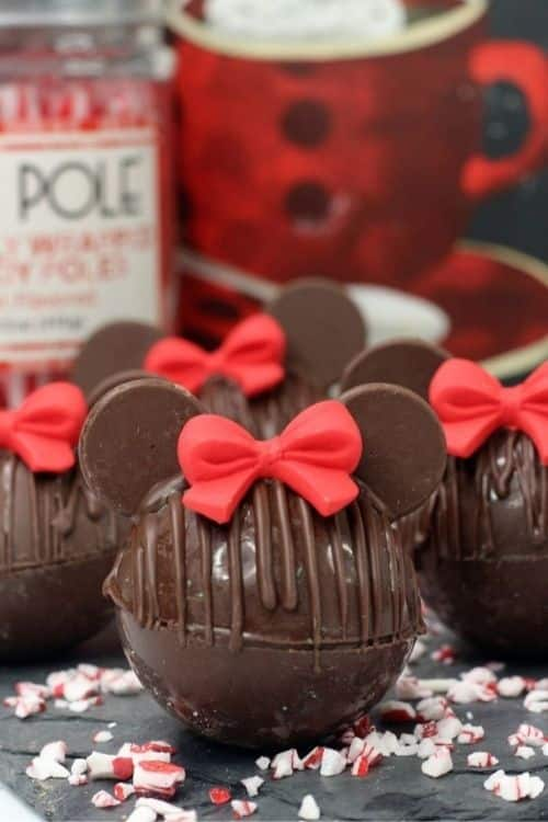 Minnie Mouse hot cocoa bombs with bows.