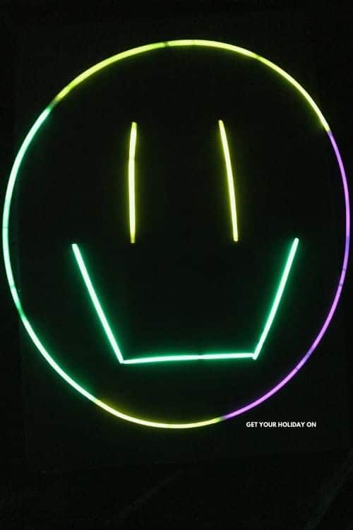 Making a smiley face out of glow sticks to make a Diy Glow in the Dark Crafts.