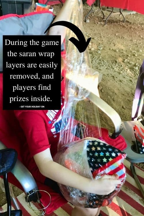 During the game the Saran Wrap layers are easily removed, and players find prizes inside.
