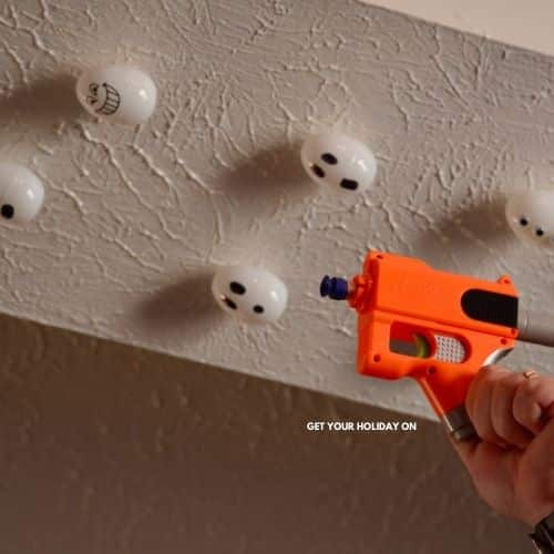 This minute to win it halloween ghost game for kids is played with a nerf gun and knocking down ghosts.