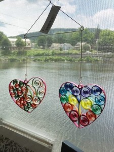 Quilled Mini Heart Mobile by Kristen Brunton of Get Your Roll On Quilling. Currently for purchase at Mormor Art Gallery and Store in Shelburne Falls Massachusetts. This quilled heart mini mobile offers the unique handmade one of a kind quilled hearts that is budget friendly and brings beauty to any room or window.