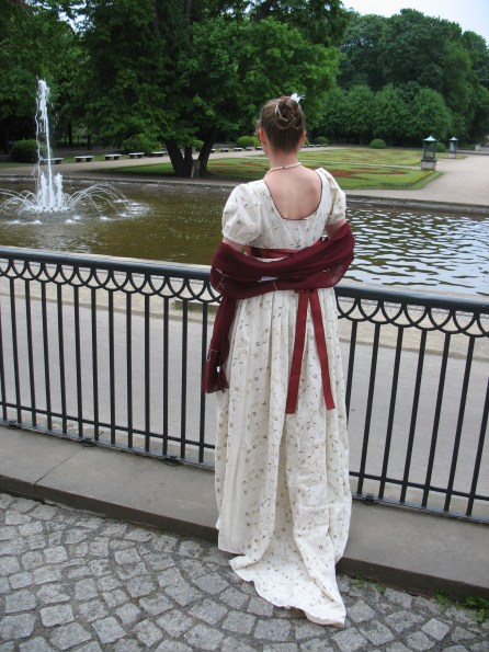 Empire dress, back view, cream and red