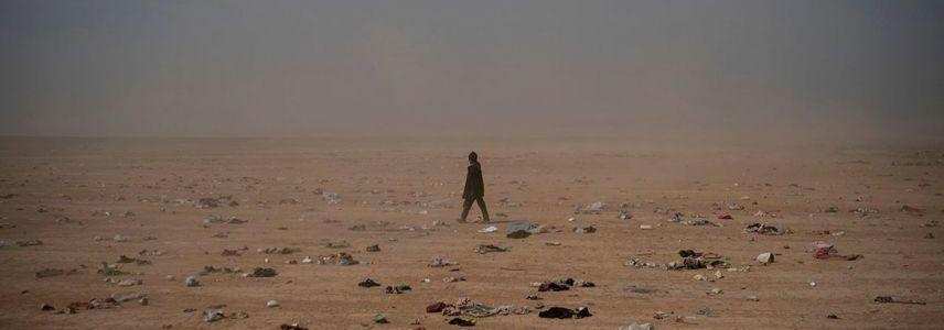 Mass grave with dozens of decapitated bodies found in last ISIS enclave