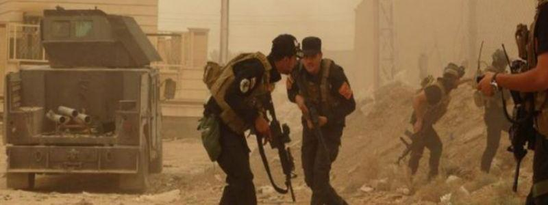 One Iraqi policeman killed and two are wounded in fierce clashes with ISIS terrorists in Kirkuk