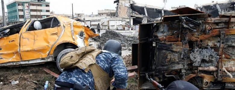 Five Iraqi officers and twelve suicide bombers killed in western Mosul in 24 hours