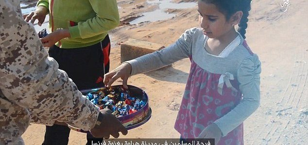 ISIS hand out sweets to children in sickening celebration of Paris terror attacks