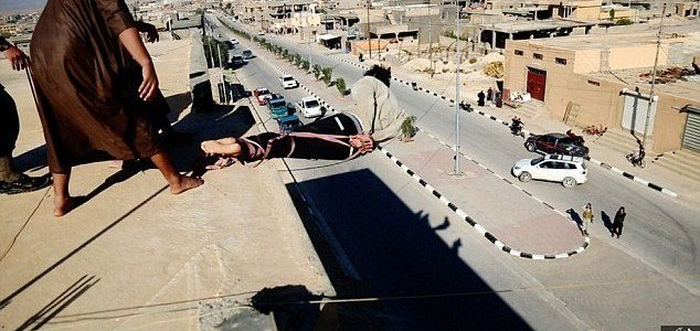 ISIS release video showing bound man being hurled off the top of a building