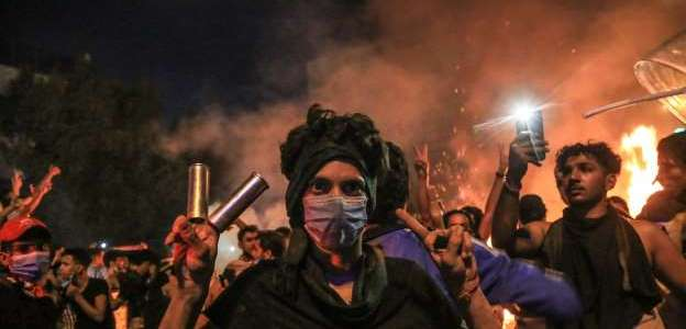 At least 18 people are dead as masked gunmen attack Iraqi protesters