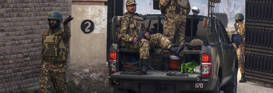 Pakistan police say that gunmen attack security vehicle as five people are killed