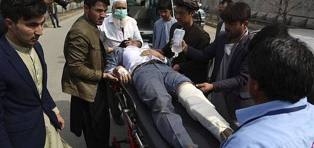 At least 27 people are killed and dozens wounded as gunmen assault political rally in Afghanistan