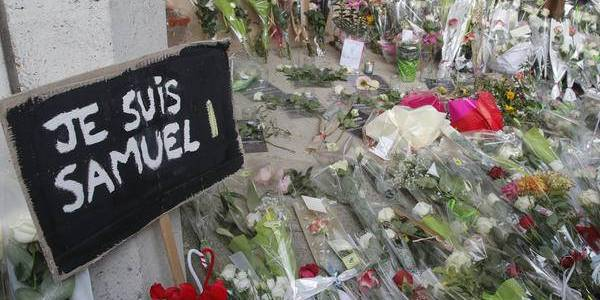 Nine people detained over beheading of history teacher in Paris suburb