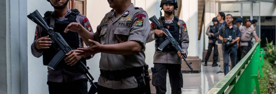 Woman shot dead after opening fire at Indonesia's national police headquarters