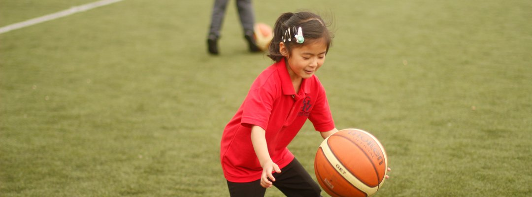 Girl playing with a ball during a PE lesson