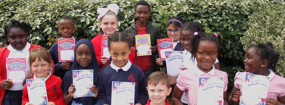 Group of children showing off their school awards