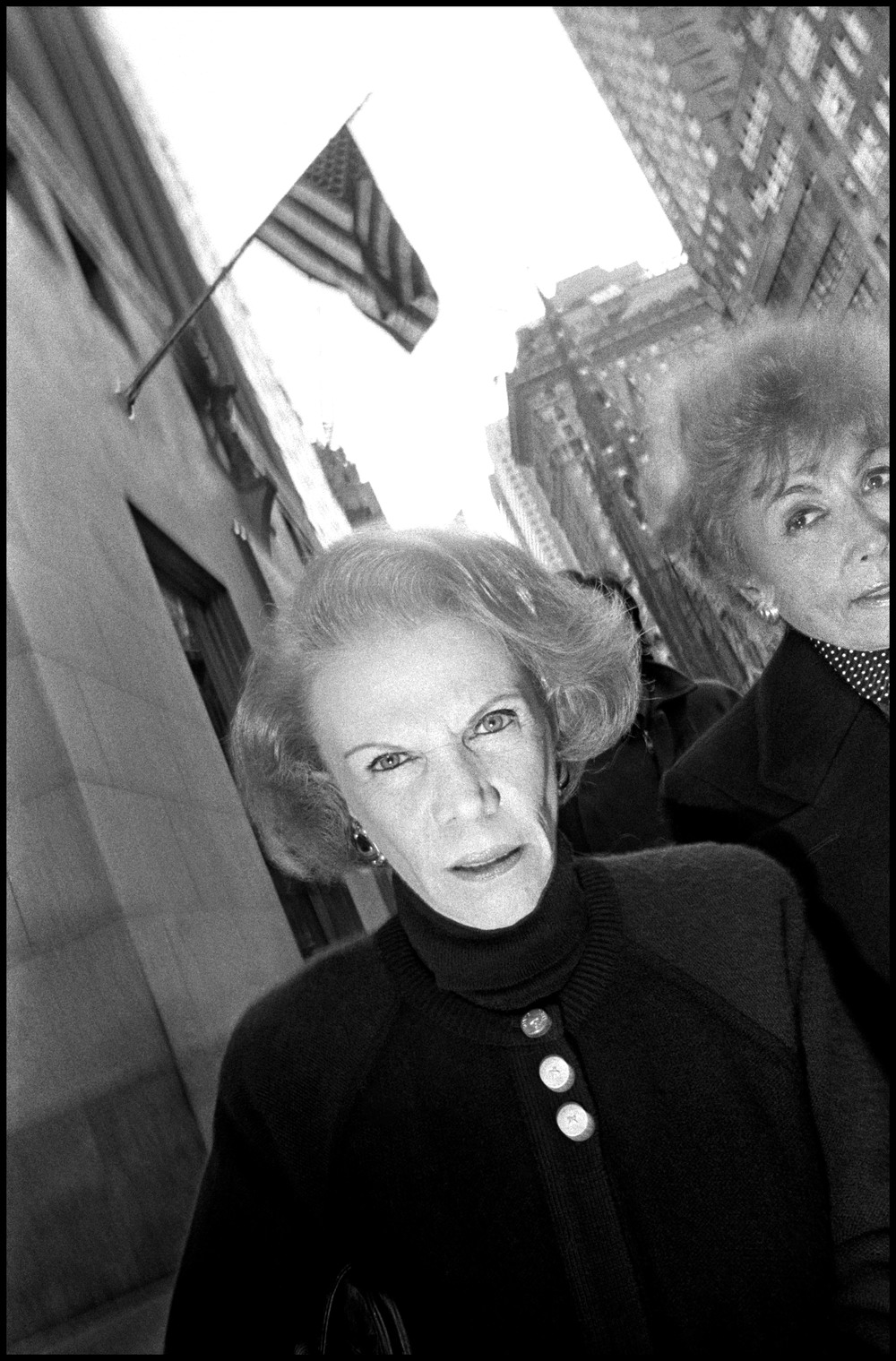 USA. New York City. Woman walking on Fifth Avenue. 1992.