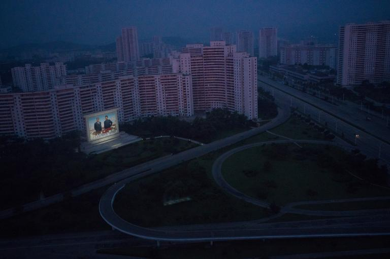 The only illumination is of Kim Il Sung and Kim Jong Il, North Korea