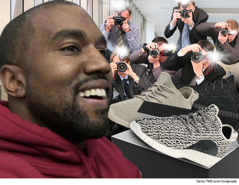 e4cc49a19ceb9 Kanye West Gives Paparazzi Free Pairs Of Yeezy Shoes ...
