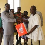 Dr Adu Boateng (left) receiving items from a delegation of lecturers from University of Education, Winneba