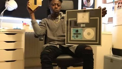 Killbeatz holding the plaques