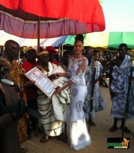 Menaye Donkor, now called Nanahemaa Menaye Afumade Afrakoma l receiving her certificate