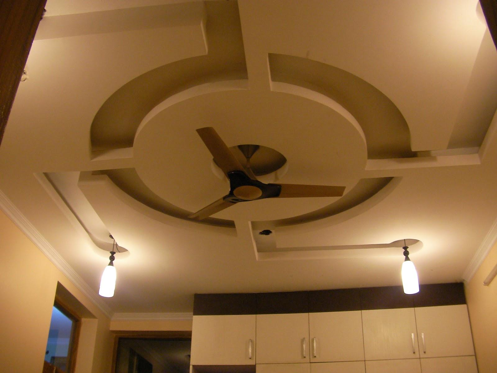 Pop Ceiling Design With A Round Design In The Center