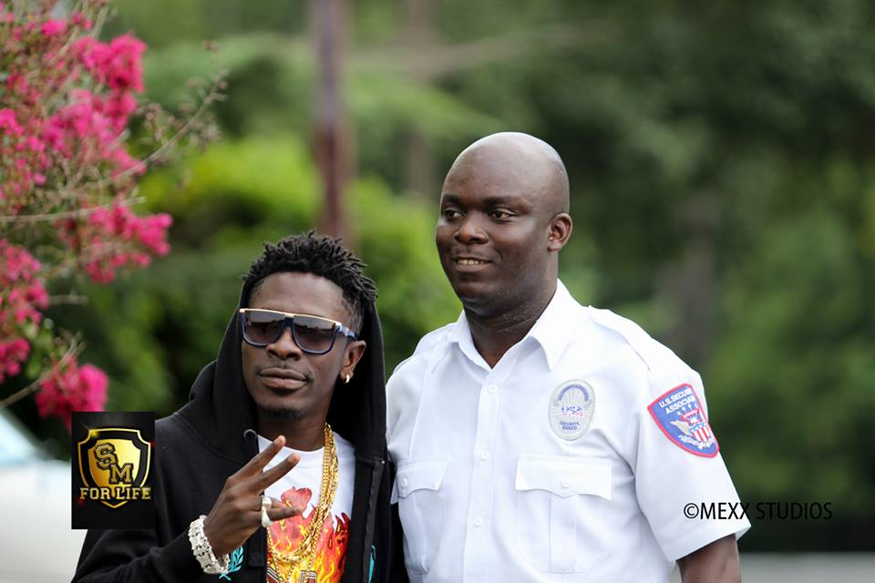 shatta Wale with the dude who will be serving their lunch........lol.........can't i joke?