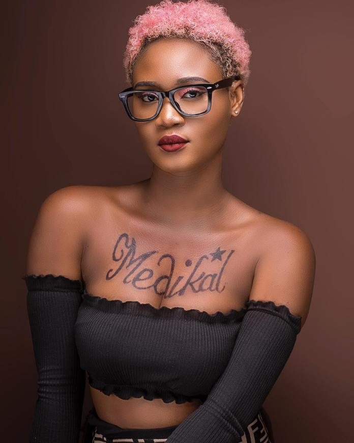Ghanaian female Musician @petrah0 is now the new @amgmedikal She has tattooed t - Petrah Wants To Snatch Fella From Fella Makafui? See Photos Of Her New Medikal Tattoo On Her Chest